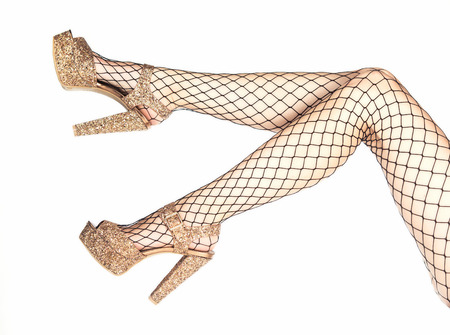 cee7d7ebb43 legs of a woman in shiny golden platform high heels shoes and fishnet  stockings PLEASE NOTE