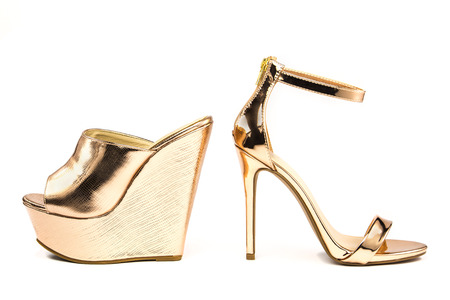 Sexy stiletto high heels with ankle strap and heavy platform mules in shiny metallic color, isolated on white backgroud