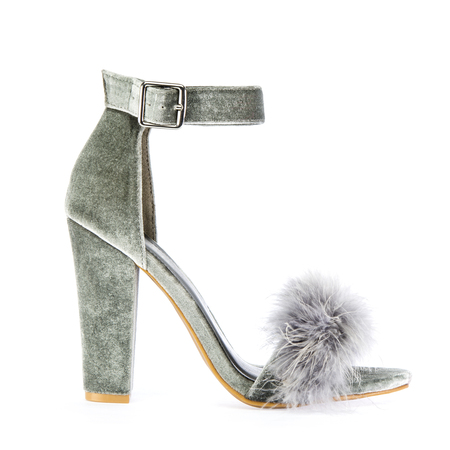 Sexy high heels shoes with ankle strap and fancy faux (fake) fur in gray suede, isolated on white background Stock Photo