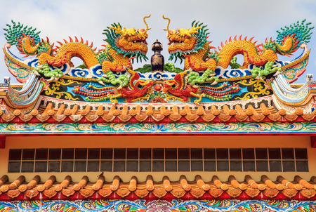 Colourful dragon on roof of joss house