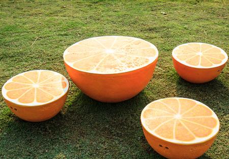 Table shaped orange in garden