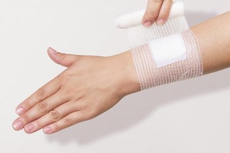forearm: Bandage on  forearm Stock Photo