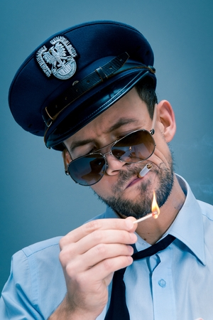 addicted: Policeman addicted to cigarettes Stock Photo