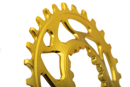 Golden oval bicycle chainring isolated at white background