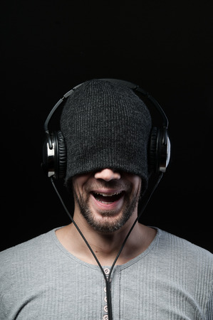 Young Man listening music with headphones on head