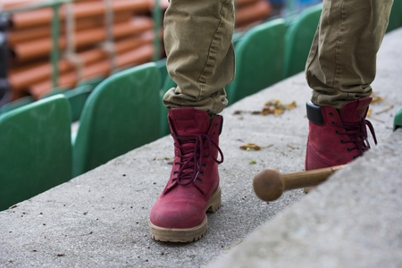 Red shoes and baseball bat