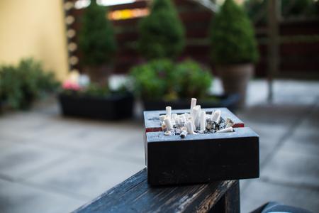 ASHTRAY ashtray full of cigarette butts Stock Photo