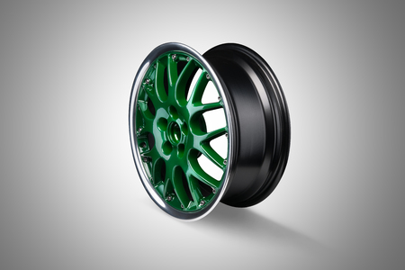 gti: Green car alloy rim at gray background