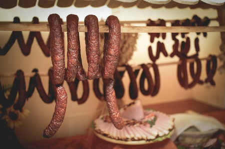 furnishings: Pieces of traditional Polish ham and sausage at wooden plate