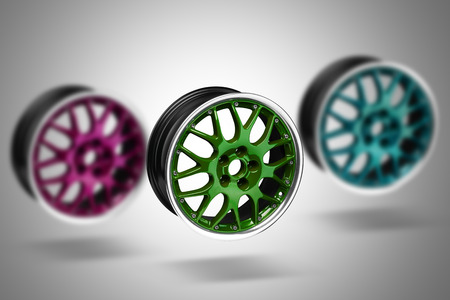 gti: Colorful alloy rims floating in the air at gray background Stock Photo