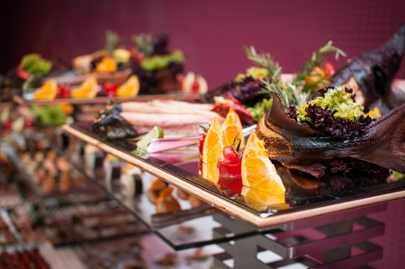 Banquet table with smoked fish Stock Photo