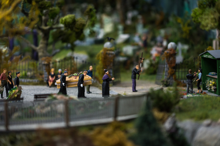 Close up of Miniature world, funeral at the cemetery Stock Photo