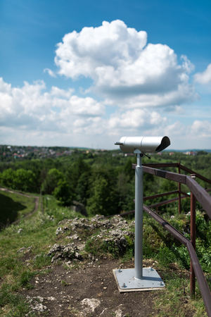 Telescope in old fortified settlement at the limestone mountain bire, Poland Standard-Bild