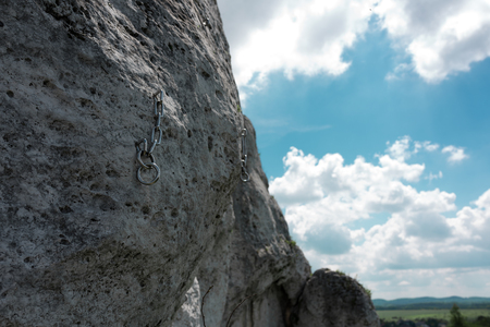 Climbing hook pushed into the limestone cliff