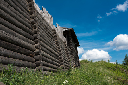 Old fortified settlement at the limestone mountain in Poland, wooden old gate Standard-Bild