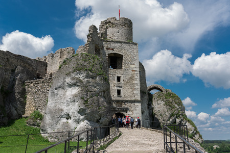 Photography of Ruins Ogrodzieniec Castle at sunny summer day. Poland May 2017 Ogrodzieniec City. Tourist heading into the castle. Editorial