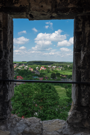 Panoramic photography of the Ogrodzieniec City from Castle Ogrodzieniec window at sunny summer day, Poland May 2017.