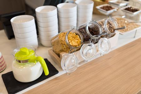 Breakfast in hotel, catering buffet. Glass filed with museli, corn flakes and oats. Lizenzfreie Bilder