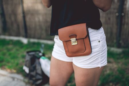 Ladies fancy brown leather bag strapped to the hips