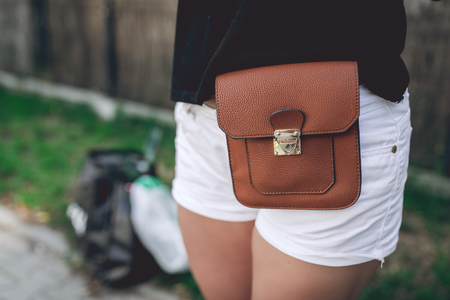 strapped: Ladies fancy brown leather bag strapped to the hips