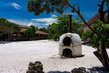 White old bread oven made of clay on sunny day. Koh Rong Samloem, Cambodia.