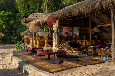 Huba Huba Resort with employees working behind the bar. Sunset Beach. Koh Rong Samloem, Cambodia. November 15, 2017 Редакционное