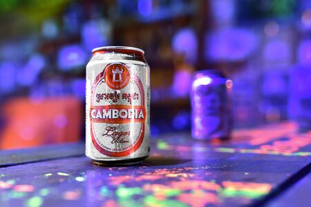One of the most popular Cambodian beer in Cambodia - can of Cambodia beer standing on the bar table illuminated by fluorescent light. Water festival - 4 november 2017, Jungle Republic, Koh rong samloe