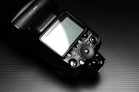 External flash lamp for dslr camera on the dark background.