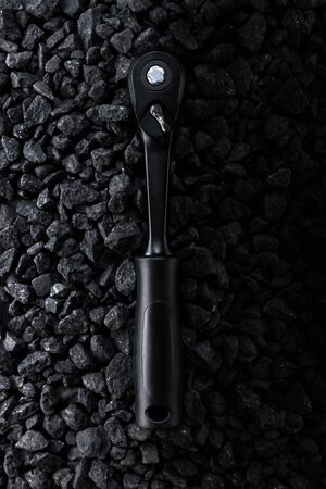 Professional reinforced black matt hex wrench placed on a stony background. View from the top. 写真素材