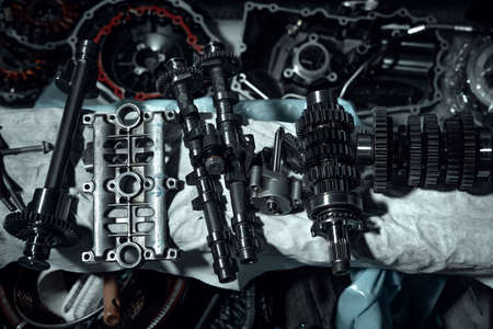 Disassembled fast motorcycle engine with visible transmission, locking valve, gear and piston parts. Sixteen valves and four cylinder motor. Zdjęcie Seryjne