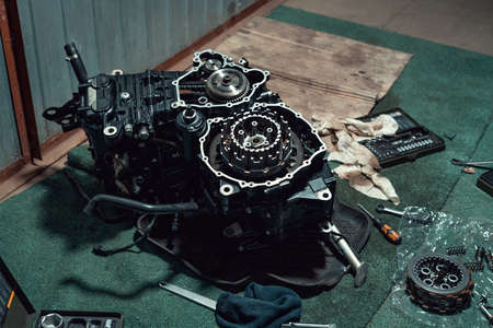 Disassembled fast motorcycle engine with visible clutch. Sixteen valves and four cylinder.
