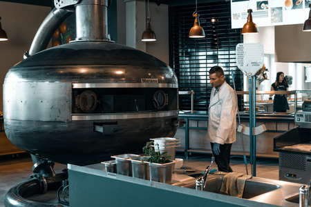 Wroclaw, Poland - December 20 2019: Official grand opening of restaurant in Shell station placed in Katy Wroclawskie. The kitchen chef testing on Marana Forni Gea pizza oven. Publikacyjne