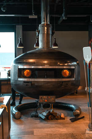 Wroclaw, Poland - December 20 2019: Official grand opening of Shell station placed in Katy Wroclawskie. Marana Forni Gea pizza oven, standing in the restaurantat the Shell Station.