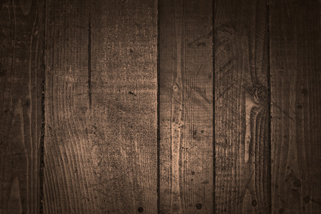 A dark grungy wooden background with a bronze appearance Stock Photo
