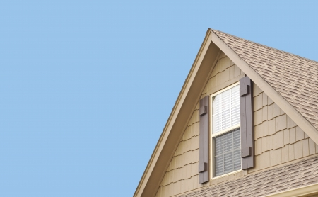 shutter: Roof gable with blue sky Stock Photo