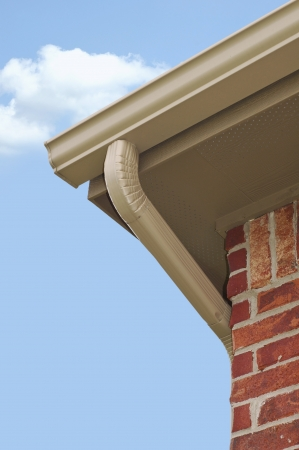 gutter: Edge of roof line with guttering and downspout