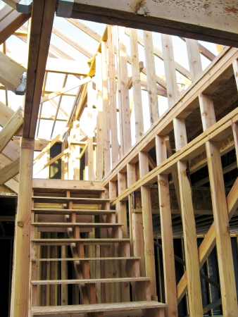 The frame of a newly constructed home with only the wooden studs Stock Photo