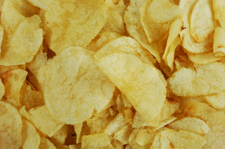 A close up of greasy potato chips
