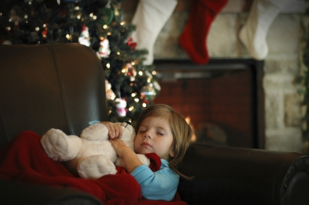 A little girl sleeps in anticipation for Christmas  photo