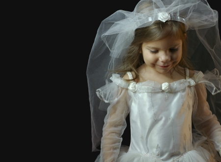 Little Girl in White Wedding Dress and Veil