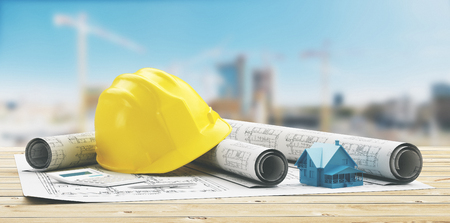Seguridad de casco amarillo para proyectos de construcción con los sitios de construcción Foto de archivo - 76791746