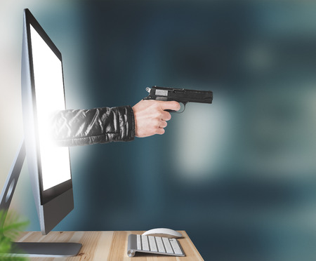 Hand with gun leaves the monitor, threats or violence