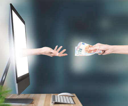 Hands with money out of the PC, online betting