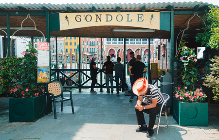 Gondolier in Venice, gondola service, pier