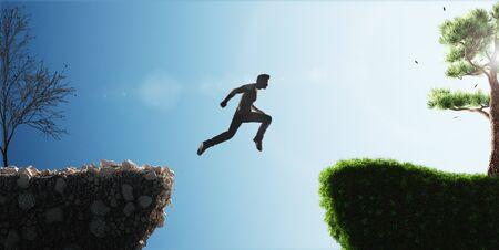 Man jumps from past to future Standard-Bild