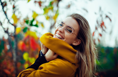 Woman smile in autumn with leaves Stock Photo