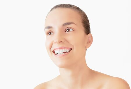 Healthy woman teeth and smile. Isolated over white background. Dental clinic.