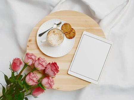 Tray with breakfast on a bed with tablet. 3d rendering
