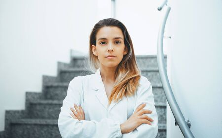 Medicine, pharmacy, people, health care and pharmacology concept. Happy young woman pharmacist