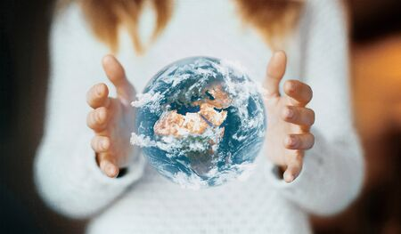 Man holding a glowing earth globe in his hands. 3d rendering